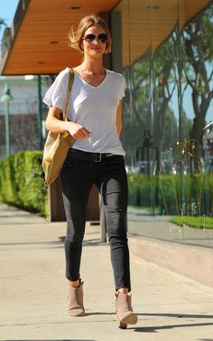Jeans, white tee and cowboy-style ankle boots.