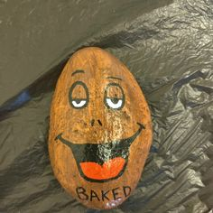 """""""Baked"""" potato $20 + shipping and handling Painted Rocks For Sale, Hand Painted Rocks, Baked Potato, Surfboard, Surfboards, Baked Potatoes, Oven Potatoes, Surfboard Table, Roasted Potatoes"""