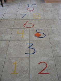 Great idea if you have a tile floor.  Hopscotch with electric tape from the dollar store and a homemade bean bag!