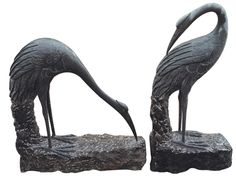 """Stone Cranes hand-crafted from granite. Large 32"""" and 39"""". Take a look at http://www.stonestatuestore.com/natural-stone-granite-animals"""