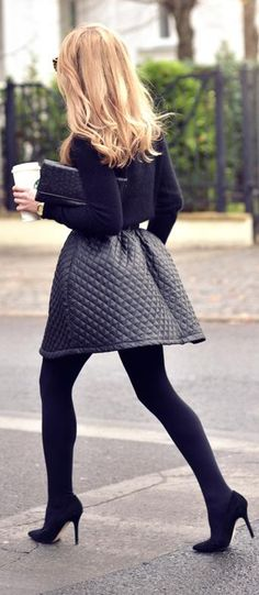 All Black Skirt Outfit #2. Wear a knee-length black quilted skirt with a black sweater, black tights, and black pumps.