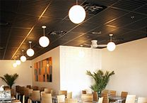 Drop Ceiling Panels: Instead of tearing down the drop ceiling, could we repurpose it with something textural or modern?