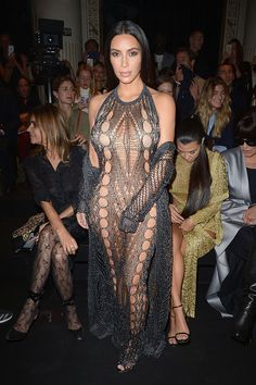 """from All the Kardashians' Paris Fashion Week Looks Kim Kardashian sported this Balmain look pulled straight from the runway. """"Today's challenge was underwear or no underwear,"""" she said of the sheer ensemble. Kim Kardashian Paris, Looks Kim Kardashian, Kardashian Style, Kardashian Jenner, Kris Jenner, Fashion Fail, Look Fashion, Fashion News, Fashion Show"""