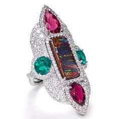 Opal, Red Tourmaline, Emerald and Diamond Ring totaling 12.77 carats.