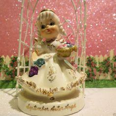 Vintage TMJ September Birthday Angel Figurine Aster Flower Pink Flower Basket