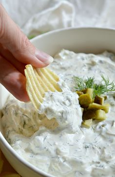 You NEED to try this Dill Pickle Dip recipe! Forget about french onion dip. This dip appetizer will be a new crowd favorite! This cold creamy dip is full of fresh dill and tangy pickles. Look Out! You may eat the entire bowlful!