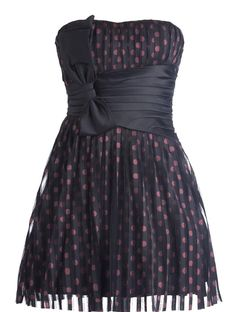 Confetti Couture Dress: Features an elegant design with subtle sweetheart neckline, pleated sheer chiffon shell with shiny pink polka dot print covering the entire base, wide asymmetrical satin waistband with an oversized bow pulled to the right, and a hopelessly romantic flared A-line silhouette to finish.