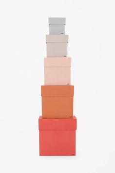 A set of five in assorted sizes, these cardboard boxes are designed to organise your larger belongings, stacking up for a colourful display. They also fit inside each other for easy storage.