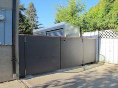 Dark Gray fiber cement boards used as fencing/gate. Modern Fence, Modern Backyard, Backyard Ideas, Privacy Walls, Privacy Fences, Fiber Cement Board, Concrete Board, Stainless Steel Gate, Steel Gate Design
