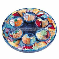 Celebrate your Passover with this Set of Seder Plate and Six Small Bowls created by renowned Jerusalem artist Yair Emanuel.   Each wooden article is hand painted with a brush using acrylic colors and then lacquered. The functional items can be used for eating and also be washed by hand in water since they are coated with several layers of lacquer.  Size: 12.6 X 2 inches.