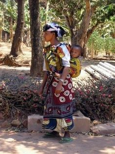 Nigerian mother wearing baby in a kanga with a one shouldered carry