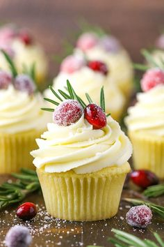 Sparkling Cranberry White Chocolate Cupcakes made with a moist vanilla cupcake with cranberry mascarpone filling and a white chocolate buttercream! Topped with sparkling sugar cranberries and a sprig of rosemary, they're the perfect holiday cupcake! White Chocolate Buttercream, Chocolate Cupcakes, Mocha Cupcakes, Banana Cupcakes, Strawberry Cupcakes, White Chocolate Desserts, Almond Cupcakes, White Desserts, Coconut Chocolate
