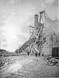 Winching the beam of the pumping engine 'Old Sal' into position, Nunnery Colliery Co. 'Old Sal' worked until 1933 Cornish Tin Mines, Steam Boiler, Industrial Machinery, Toy Trains, Mining Equipment, Old Factory, Industrial Photography, Factories, Steam Engine