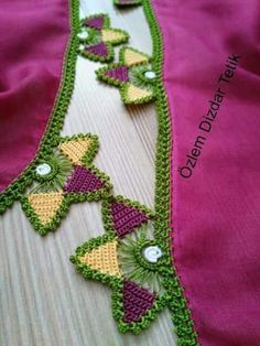 This Pin was discovered by Mel Saree Tassels Designs, Saree Kuchu Designs, Crochet Buttons, Crochet Lace, Kutch Work Designs, Doodle, Applique Quilt Patterns, Crochet Squares, Hand Embroidery Designs