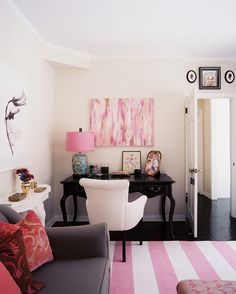 Traditional Work Space: Pink accents in a corner office area.