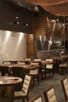 Tiger Restaurant With Wooden Wall Covering Panelling And Fish Net Ceiling Decor Ideas