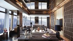 - The Ritz-Carlton Suite features a spacious living area with dramatic views of the Hong Kong Victoria Harbour area and Tsim Sha Tsui