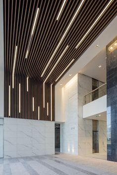 Wood slat ceiling linear lighting google search for Linear organization in architecture