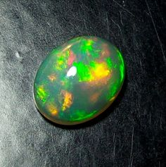 Natural Ethiopian Multi Fire Flashy Opal 1.4 TCW 9x7MM Cabochon Fine Quality A38 #Unbranded