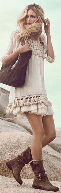 Short cream colored dress made of a delicate fabric like chiffon. The fringed hem is classic boho chic. Pairing it with midcalf, brown leather boots makes this dress rock. Twin-Set S/S 2013