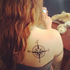 My compass tattoo with a fleur de lis