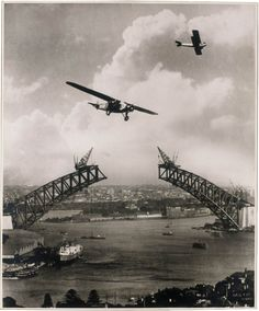 """Sydney Harbour Bridge, Sydney, Australia from the State Library of New South Wales And now for the first of a dozen great vintage shots of the iconic Harbour Bridge. This particular shot is a construction shot from 1930 which also features two airplanes, Charles Ulm's """"Southern Sun"""" & a Gypsy Moth. (The planes were added to the image after the fact to make it more dramatic.) More photos of the bridge here."""