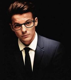 Louis looks so cool and awesome in that suit and tie and glasses.