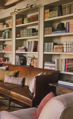 (via n e u t r a l s / Library with Brown Leather Sofa | Content in a Cottage)