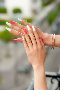 neon pink and white pointy nails by @fluffynails