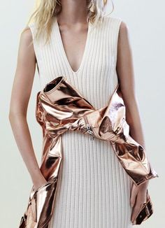 Gold PVC jacket is tued around the waist of girl wearing cream knit dress.. DIY the look yourself: http://mjtrends.com/pins.php?name=gold-pvc-for-outerwear