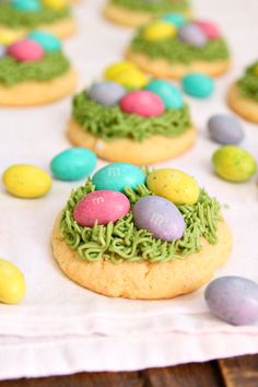 "Easter Grass Sugar Cookies Recipe - sweet and soft sugar cookies topped with ""Easter grass"" frosting and M&M's Chocolate Eggs! Fun recipe for Easter from RecipeGirl.com #ChocolatewithM #ad @mmschocolate"