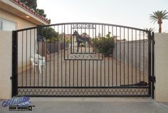 Automatic Wrought Iron Driveway Gate with custom plasma cut detail. Wrought Iron Driveway Gates, Double Gate, Guard Dog, Plasma Cutting, Deck, Detail, Outdoor Decor, Model