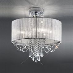 The Empress Ceiling Light by Franklite Lighting is available from Luxury Lighting. The Franklite Empress Ceiling Light is in a chrome finish with a drape of crystal glass drops cascading through a silver shade. Ceiling Lights Uk, Crystal Ceiling Light, Semi Flush Ceiling Lights, Flush Lighting, Luxury Lighting, Accent Lighting, Chandelier Light Shade, Flush Mount Chandelier, Glass Chandelier