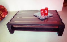 Coffee table made from a pallet. Stained with glass top.