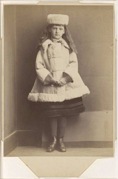 Lewis Carroll, Xie Kitchin, at about age eight, in fur-trimmed coat and hat, c.1873