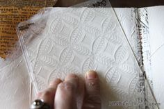 Use embossing folders to press into your gesso to make some texture/patterns in your backgrounds.