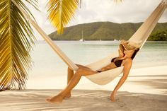 Royalty-free Image: bikini woman napping in a hammock at the…