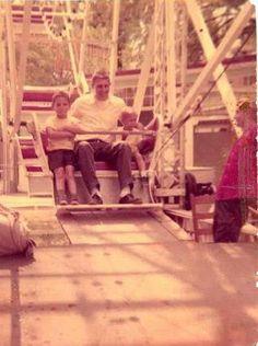 My Dad & brothers riding ferris wheel
