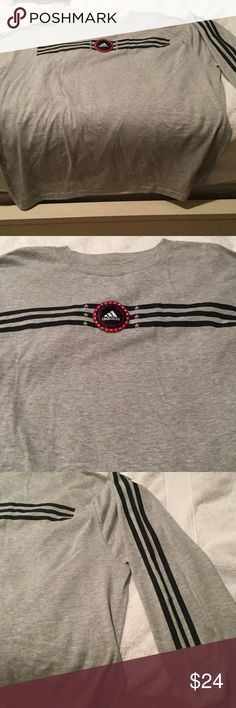 Adidas xl Heather grey long sleeve t nwot Men's xl adidas Heather grey long sleeve t shirt with subtle and unique logo on front and three stripes done the left shoulder to wrist on that side only . Cool look and NWOT adidas Shirts Tees - Long Sleeve