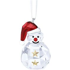 This cute and playful snowman will rock the restive season. His body is crafted in clear crystal. Two sparkling stars and a Santa's hat in shimmering ... Shop now