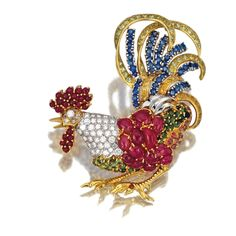 Gem-set and diamond brooch, Seaman Schepps. Designed as a crowing cockrel, decorated with cabochon rubies, brilliant-cut diamonds of brown and near-colourless tints, circular-cut sapphires, and variously-cut gemstones, mounted in yellow gold, signed Seaman Schepps, maker's marks.