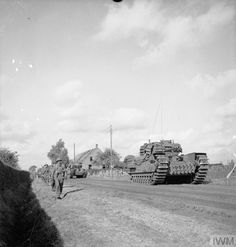 Churchill tanks and infantry advance during the attack by Division on an enemy pocket near Overloon, 14 October British Army, British Tanks, Ww2 Tanks, D Day, Photo Dump, Churchill, Armed Forces, World War Two, Wwii