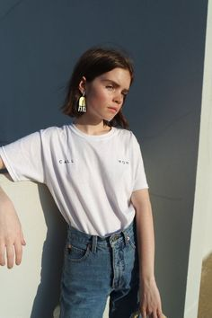 Reese Blutstein (@double3xposure) in white tee and jeans