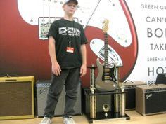 Here is one of the Custom Trophies that we built for Fender with a real Fender Guitar.
