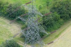 An aerial photograph of an electricity pylon Photography Gallery, Aerial Photography, Utility Pole, Arch, Commercial, Outdoor Structures, Garden, Image, Garten