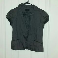 H&M Short Sleeve Blazer Pre-loved, charcoal gray, short-sleeve blazer. Nearly all cotton. Only damage is it's missing a single, large button (shown in picture), but there is a replacement button seen to the inside seam. Has a collar and fits snug at the button of the sleeves. Decorative (not functional) pockets on the front. Great addition to a casual, yet classy outfit! H&M Jackets & Coats Blazers