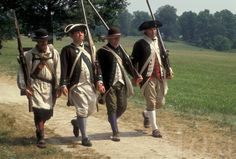 AJ2774, Valley Forge Park, reenactment, Valley Forge, soldiers, Pennsylvania, Four men dressed in Continental Army soldier costumes march to...