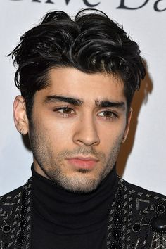Zayn Malik, The Brooding Wave Toggle Zayn is proof that it's possible to look great at every stage of growing out a buzz cut.