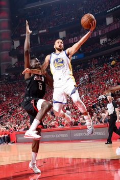 Stephen Curry of the Golden State Warriors goes to the basket against the Houston Rockets during Game Two of the Western Conference Finals of the...