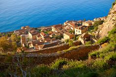 Arial view of Monemvasia Byzantine Island castle town with acropolis on the plateau.   Peloponnese, Greece